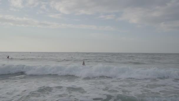 Pretty girl with surfboard on beach.