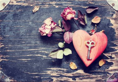 Vintage key on heart shape with flowers stock vector