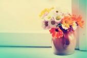 bright field flowers in ceramic vase