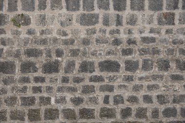 Old grey stone wall, building as background, wallpaper