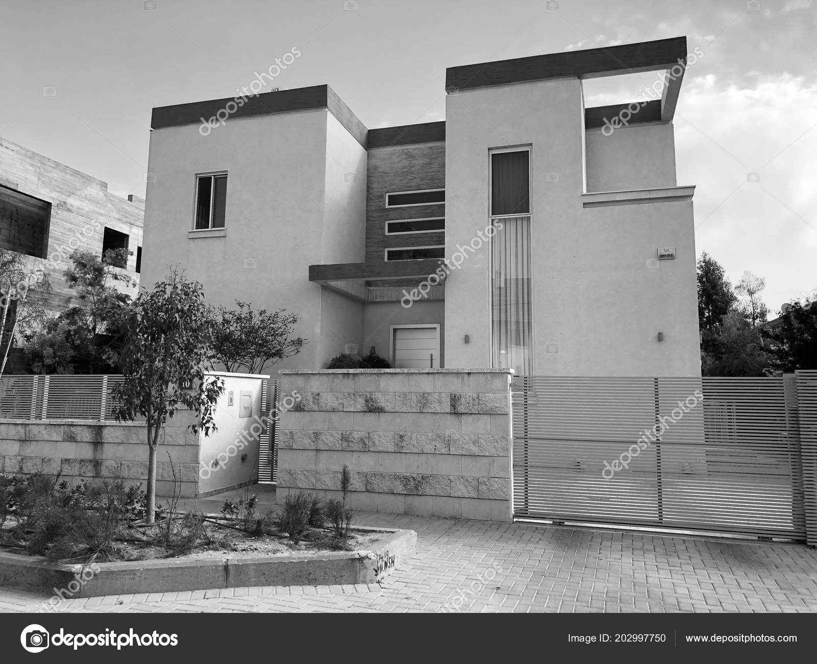 Private modern houses with big wooden fence on the streets in rishon lezion israel