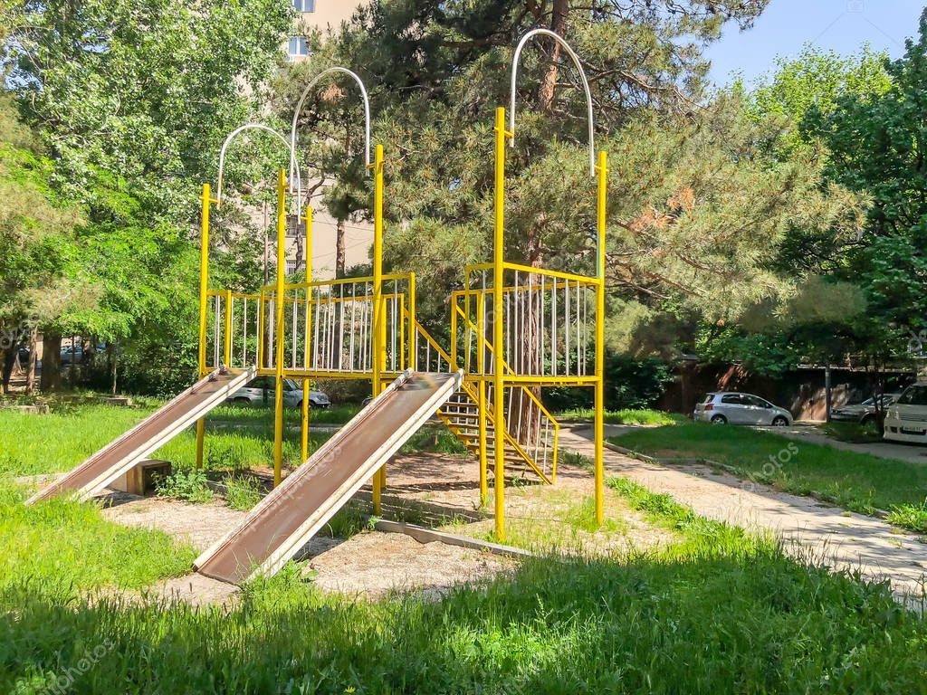 TBILISI, GEORGIA -  - MAY 17, 2018: Children's playground for games. Iron construction in the courtyard near the residential building. Springtime in the city.