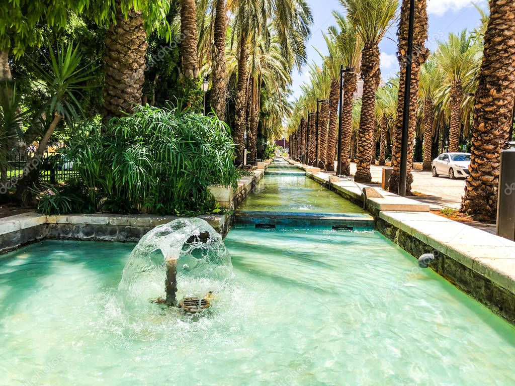 RISHON LE ZION, ISRAEL -JUNE 18, 2018: Fountains in city park  in Rishon Le Zion, Israel.