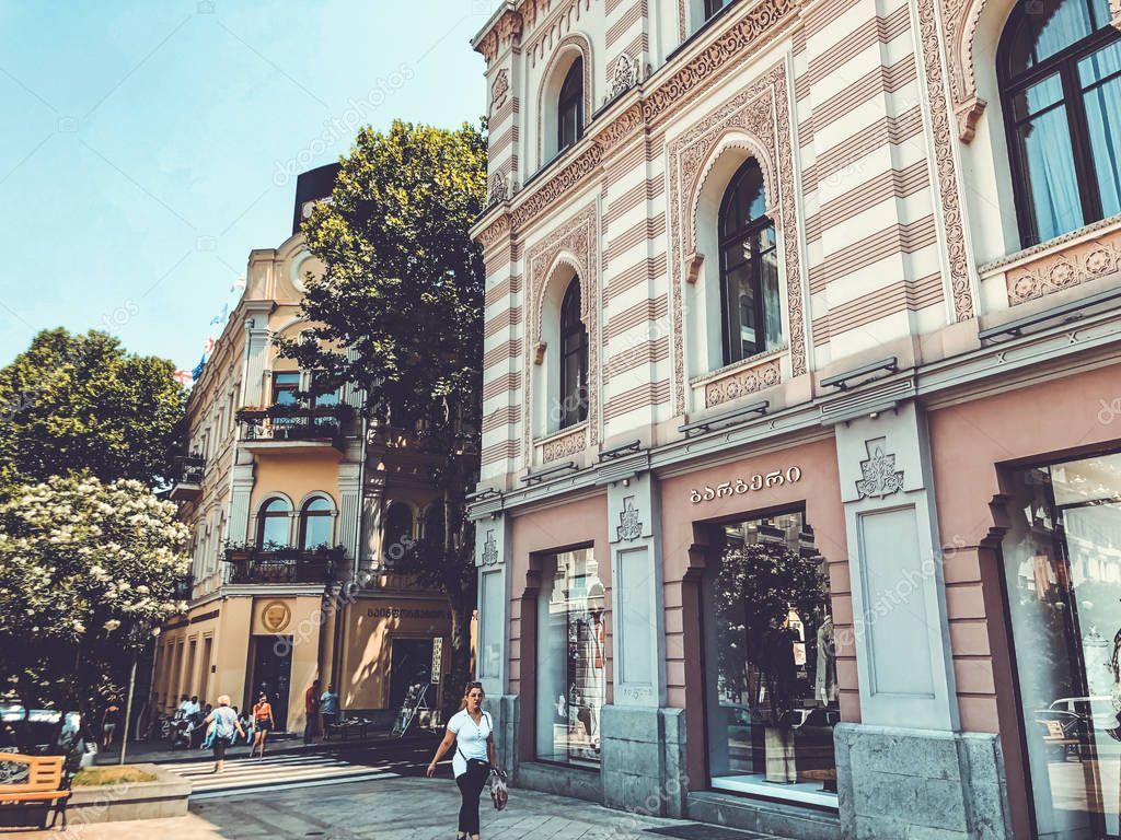 TBILISI, GEORGIA - July 10, 2018: Burberry brand shop. View of the old city hall building's facade and old in Tbilisi, Goergia