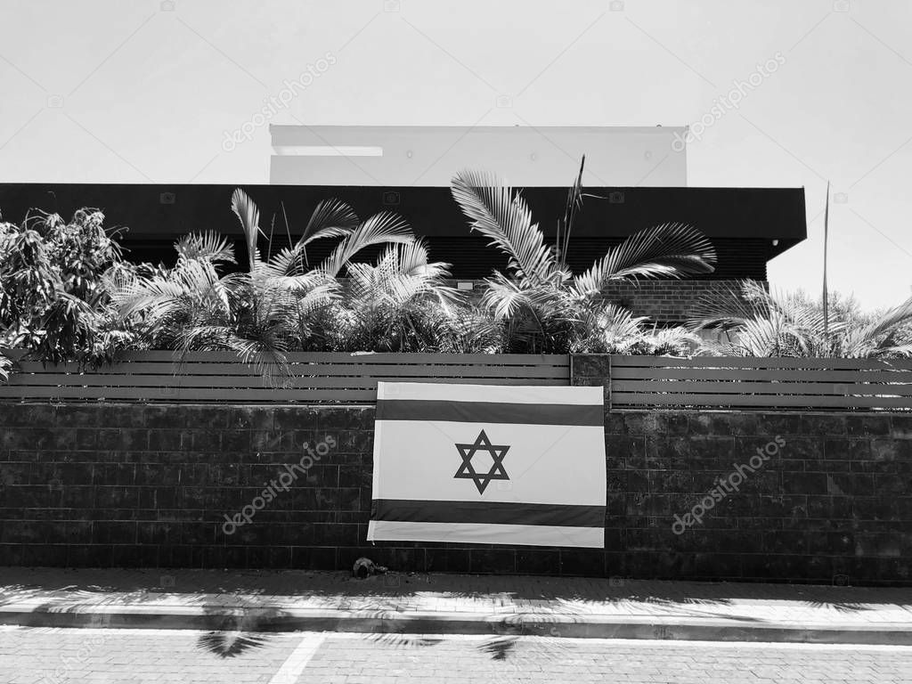 RISHON LE ZION, ISRAEL - June 27, 2018 Israel's national flag, which is a private home fence in Rishon Le Zion, Israel