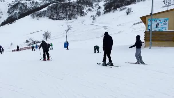 BAKURIANI, GEORGIA - JANUARY 24, 2020: Skiers are preparing to get down from the mountain