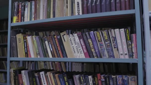 Books in old vintage retro library. 4K UHD slow gimbal pan.