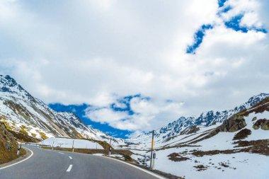 Road amoung snowy Alps mountains, Fluelapass, Davos,  Graubuenden Switzerland