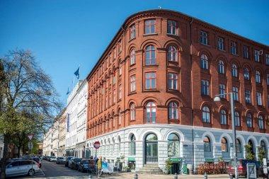 COPENHAGEN, DENMARK - MAY 5, 2018: urban scene with city street and colorful buildings in copenhagen, denmark