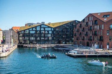 COPENHAGEN, DENMARK - MAY 5, 2018: urban scene with city river and buildings in copenhagen, denmark stock vector