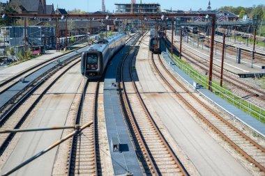 COPENHAGEN, DENMARK - MAY 6, 2018: scenic view of train riding on tracks in copenhagen, denmark