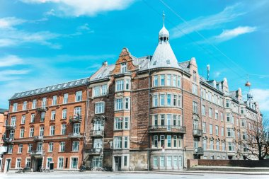 urban scene with beautiful architecture of copenhagen and cloudy sky, denmark