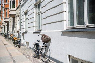 urban scene with bicycles parked on street in copenhagen, denmark