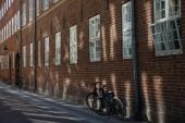 urban scene with bicycles parked on street, copenhagen, denmark