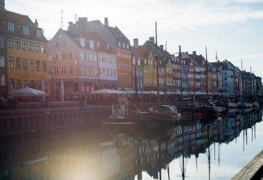 COPENHAGEN, DENMARK - 06 MAY, 2018: buildings, yachts and boats in the Old Town of Copenhagen, Denmark stock vector