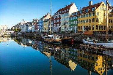 COPENHAGEN, DENMARK - 06 MAY, 2018: Nyhavn pier with buildings, yachts and boats in the Old Town of Copenhagen, Denmark stock vector