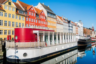 COPENHAGEN, DENMARK - 06 MAY, 2018: Nyhavn pier with buildings, ships, yachts and other boats in the Old Town of Copenhagen, Denmark stock vector