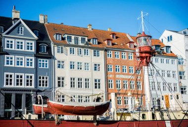 COPENHAGEN, DENMARK - 06 MAY, 2018: Nyhavn pier with buildings and boats in the Old Town of Copenhagen, Denmark