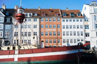 COPENHAGEN, DENMARK - 06 MAY, 2018: Nyhavn pier with color buildings and boats in the Old Town of Copenhagen, Denmark stock vector