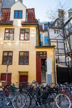 bicycles parked near house on street in copenhagen, denmark