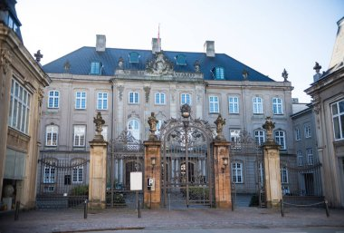 old gates, blank card and beautiful historical building in copenhagen, denmark