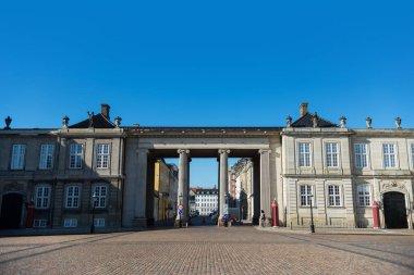 COPENHAGEN, DENMARK - MAY 6, 2018: Columns and historical buildings on square with pavement, copenhagen, denmark stock vector