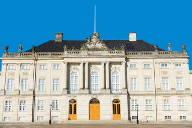 Beautiful architecture of historical Amalienborg castle with columns and statues in copenhagen, denmark stock vector
