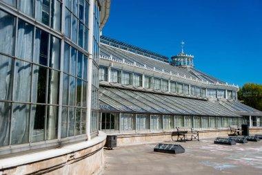 COPENHAGEN, DENMARK - MAY 6, 2018: Palm house in botanical garden under bright blue sky