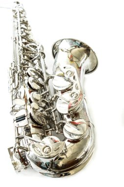 musical saxophone in studio on white background