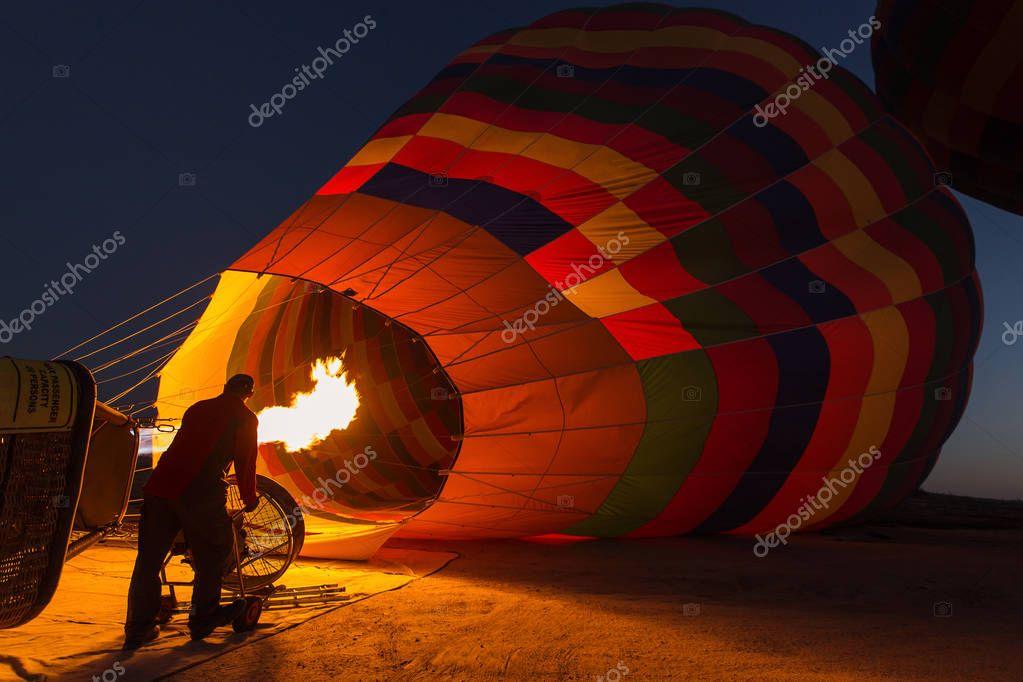 Staff preparing the balloon for fly over Cappadocia in Goreme, Cappadocia - Turkey.