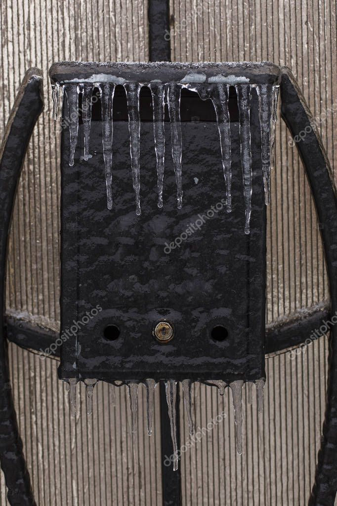 Frozen mailbox with iciclas on it in winter time