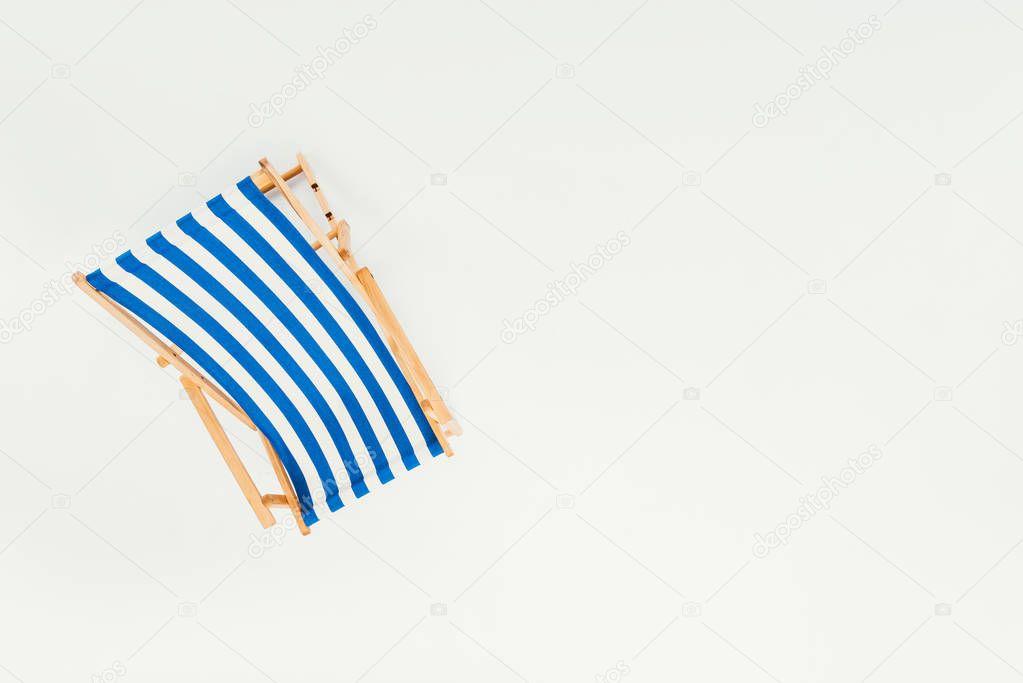 top view of single striped beach chair isolated on white