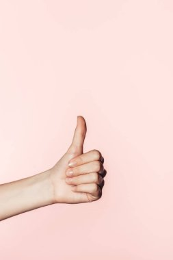 Cropped image of woman doing thumb up gesture isolated on pink background stock vector
