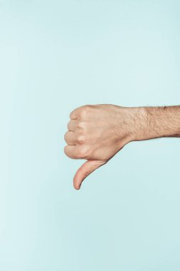 cropped shot of man doing thumb down gesture isolated on blue background