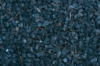 close up of background with black stones or gravel