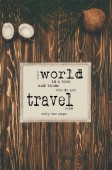 top view of vintage map and coconuts on wooden surface with world and travel inspection