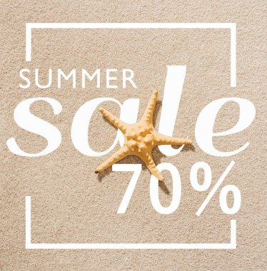 top view of dry starfish lying on sandy beach with summer sale discount