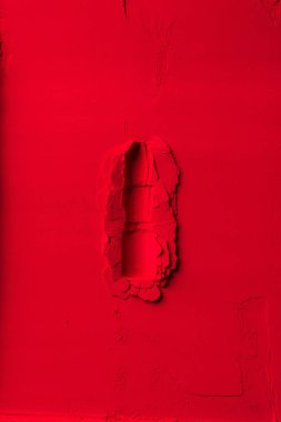 top view of shape of lipstick on red powder