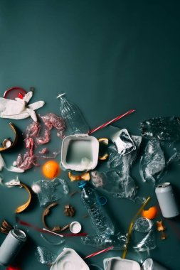 top view of trash and leftovers flowing in water, environment protection concept