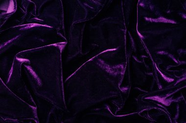 top view of dark violet shiny velvet textile as background