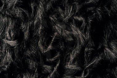 top view of furry black textile as background