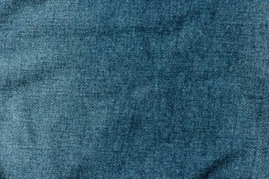 top view of dark blue denim textile as background