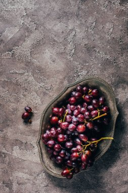 top view of fresh ripe juice grapes on vintage plate