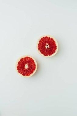 top view of juicy grapefruit halves, on grey