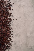 top view of spilled coffee beans on concrete surface