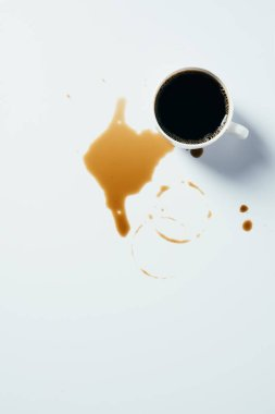 Top view of cup of black coffee standing messy on white surface stock vector