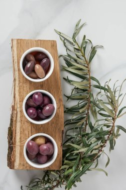 top view of ingredients for olive oil preparation on log