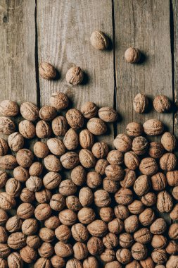 top view of ripe tasty organic walnuts on wooden table