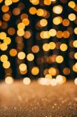 paillettes scintillanti doro con bokeh sullo sfondo, concetto di Natale
