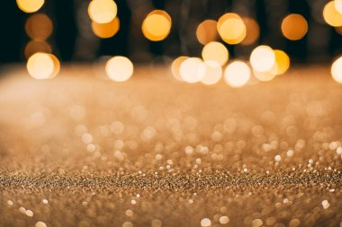 Golden sparkling sequins with bokeh on background, christmas concept stock vector